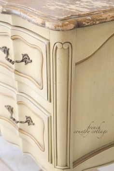delicate hardware a worn, chipped, painted faux marble top and details galore