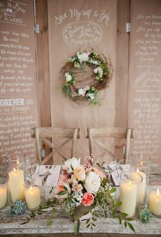The unfinished wood of the tables and chairs gives this table setting a wonderful juxtaposition to the romantic flowers and candles.