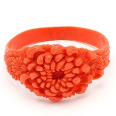 CARVED CORAL TONE CHRYANTHEMUM CELLULOID BANGLE. Originally pinned by Colleen Abbott (colleen466)