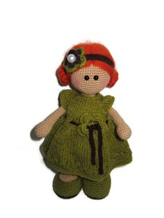 My name is Solja and I'm a handmade crochet doll. I'm about 25 cm tall, I have a fair complexion, hand painted marks under my eyes, and my hair is needle felted out of sheep wool.I am stuffed with polyestre stuffing.