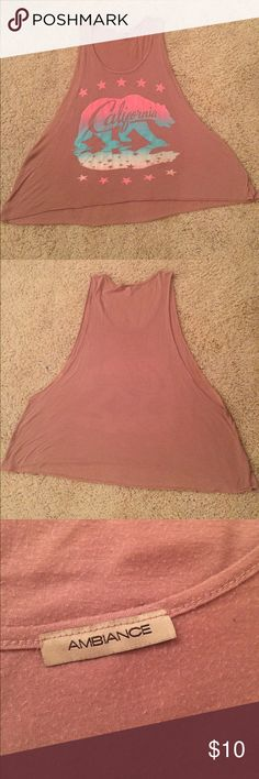 Ambience California Bear Muscle Crop Top Neon Ambience brand muscle style crop top in a mauve pink color with a California graphic design with neon pink and green. The tag is missing but this fits a size M/L. Is in used condition but no stains or rips, just some wash wear. Measurements- CHEST: 22 in. LENGTH: 22 in. If you have any questions please don't hesitate to ask! Ambience Tops Crop Tops