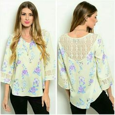 """Floral lace tunic top blouse Size Large 11/12 NWT Gorgeous light yellow tunic blouse with a floral design done in hues of pastel blue and purple. 3/4 sleeve with lace detail and lace on the upper back. Size Large. Fits ladies 11/12. 26"""" long. Silky smooth polyester. Not sheer or see through. Brand new with tag. Jill Marie Boutique Tops Blouses"""