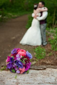 bouquet with out of focus couple in background