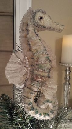 "Seahorse Tree Topper.  I added crystals, gems, pearls to this Paper Mache' seahorse. It was a good sized (7.5 "") hanging ornament I wired to the top of my coastal Christmas tree. :)"