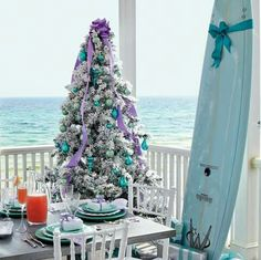 Purple and Turquoise Christmas Tree. If it's still warm enough for al fresco dining, take the tree outdoors! Purple Christmas Tree, Turquoise Christmas, Beach Christmas, Coastal Christmas, Xmas Tree, All Things Christmas, Christmas Home, White Christmas, Christmas Holidays