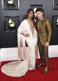 Priyanka Chopra, left, and Nick Jonas arrive at the 62nd annual Grammy Awards at the Staples Center on Sunday, Jan. 26, 2020, in Los Angeles. (Photo by Jordan Strauss/Invision/AP) Ariana Grande, Priyanka Chopra Hot, Couple Moments, Plus Clothing, Ralph And Russo, Nick Jonas, Hollywood Life, Popular Videos, Photo Editor