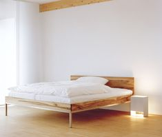 Bed LITA by Philipp Mainzer with seamless brushed stainless steel legs and solid wood frame. Floor light: SEAM TWO by Mark Holmes. / www.e15.com #e15 #solidwood #oak