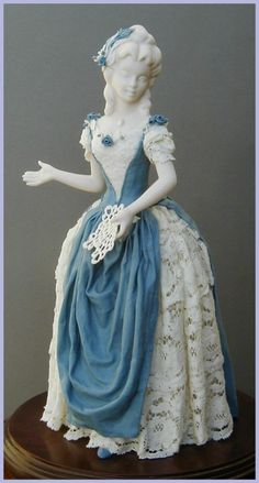 Victorian Period Porcelain Figurine. Yes, porcelain. Not cloth, not textiles, not real lace, porcelain.