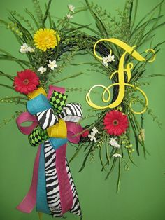 """Monogram """"F"""" on a wreath with colorful flowers and fun bow!"""