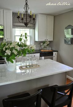 Wall color is Revere Pewter in a matte finish.  Awesome kitchen revamp from Dear Lillie