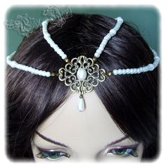 The NeverEnding Story Childlike Empress Inspired Pearl Headpiece Headdress Tiara Bridal Wedding Hair Accessory Head Piece. $29.00, via Etsy.
