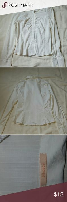 Forever 21 blouse Ivory. Thin material with ribbing. It bunches,  but also blouses at the chest. Small and very cute. Forever 21 Tops Button Down Shirts