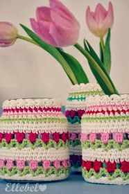 this is from a RedHeart afghan called Flowers in a Row.  It has been beautifully adapted to fit smaller jars or vases.   Nederland Haakpatroon / Dutch crochet pattern.
