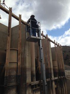 Removing old trash frame at villa park dam