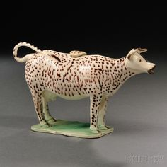 Staffordshire Cream-colored Earthenware Cow Creamer | Sale Number 2663B, Lot Number 1101 | Skinner Auctioneers. $338