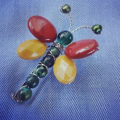 A gift I received many years ago -- a pin made of beads and semi-precious stones. It's a cute idea to make with broken jewelry. Use it as an accessory or add it to gift wrapping or make Christmas tree ornaments with it...TADA!  #crafts #brooches #dragonfly #jewelry #upcycle #beads
