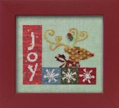 The title of this cross stitch pattern is Christmas Joy from Art To Heart that includes the Just Another Buttcon Company buttons.