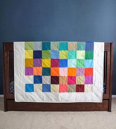 Vibrant and colorful, this cozy quilt features 64 solid squares of the brightest, boldest colors arranged to complement and contrast. The quilt is carefully crafted and backed with 100% cotton fabric. Handmade by the Quilting Duo.