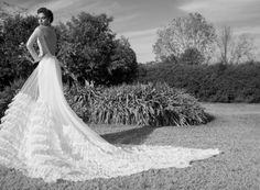 Maya wedding gown, Style #1507 Dropped shoulder long sleeves sheath made of beaded lace over skin tone lining and chiffon skirt with long church train