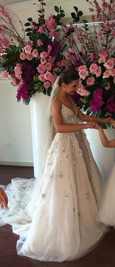 The embellishments on this couture bridal gown make the design. Tou can have custom a-line #weddingdresses like this made in a price range you can afford. We are in the USA and also offer #replicas of haute couture wedding dresses that will be similar to the original but cost way less. Email us for pricing. Dariuscordell.com