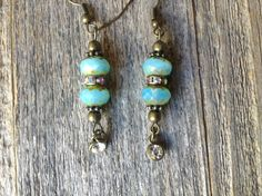 $14  Aqua Blue and Rhinestone Earrings/Come to my shop... A personal favorite from my Etsy shop https://www.etsy.com/listing/480898109/aqua-blue-and-rhinestone-earrings