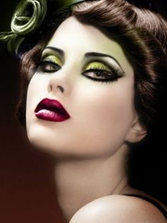 This makeup is amazing! The green eyes complement the red lips well, a la color theory. :)