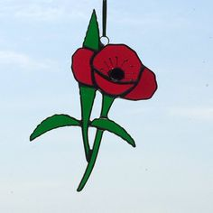 Remembrance poppy stained glass window hanging.