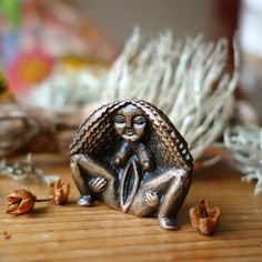 "Avocado Stone Faces — ""Síofra"" - Sheela na Gig - Birthing Stone - Bronze Figurine Names With Meaning, Stone Carving, Wood Carving, Sculptures, Lion Sculpture, Mother Goddess, Bronze, Ancient Art, Goddesses"