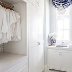 Gray Laundry Room Walls with White Dove Cabinets