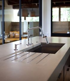 Integrated drainboard in kitchen countertop, Kohler Karbon faucet with multiple, movable joints