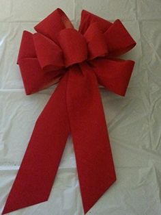 """The ribbon is a wired 100% polyester fabric ribbon with 100% acrylic flocking. It is bright red velvet. The edges of the ribbon are covered with metallic gold thread. A set of 5 hand-made wired bows ideal for decorating either indoors or outdoors. These bows measure about 10"""" across and... see more details at https://bestselleroutlets.com/arts-crafts-sewing/crafting/fabric-ribbons/product-review-for-5-large-10-hand-made-christmas-bows-red-velvet-indoor-outdoor-wreath-rib"""