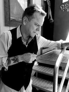 Kiefer Sutherland Photos Photos - This image has been converted to black and white.)  Musician Kiefer Sutherland poses backstage during day 3 of 2017 Stagecoach California's Country Music Festival at the Empire Polo Club on April 30, 2017 in Indio, California. - 2017 Stagecoach California's Country Music Festival - Day 3