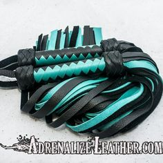 Turquoise and black cowhide flogger set. www.adrenalizeleather.com www.etsy.com/shop/adrenalizeleather #kink #leather #fetish #bondage #bdsm #gear #toys #sale #leathermen #leatherwomen #leatherwork