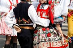 Czech traditional costumes are often beautifully embroidered. Because so many regions of the Czech Republic have their own traditional folk costumes, it is difficult to generalize what represents typical Czech dress. Here, you see traditional costumes at a Czech folk festival.
