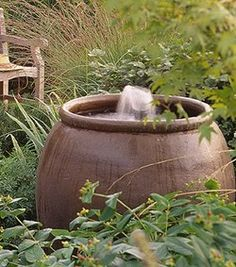 Urn Bubbler  Enjoy the sound of water splashing in this simple urn with a bubbler. In addition to masking neighborhood noises, a fountain provides a welcome water source for birds and other wildlife.