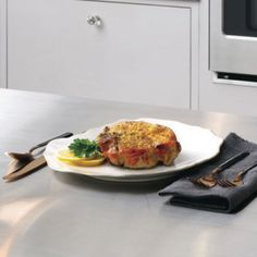 Tight image of pork chop on counter French Door Wall Oven, Electric Wall Oven, Single Oven, Oven Cleaning, Oven Racks, Pork Chop, Fresh Vegetables, Counter, Favorite Recipes