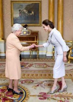 Angelina Jolie looked humbled when she was presented with the Insignia of an Honorary Dame Grand Cross of the Most Distinguished Order of St. Michael and St. George by Queen Elizabeth II herself in London on Oct. 10, 2014.   Photo: © Rex/Rex USA