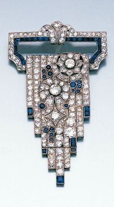 An art deco diamond and sapphire cascade brooch, c. 1925.: