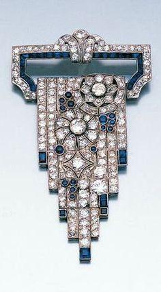 An art deco diamond and sapphire cascade brooch c. 1925.