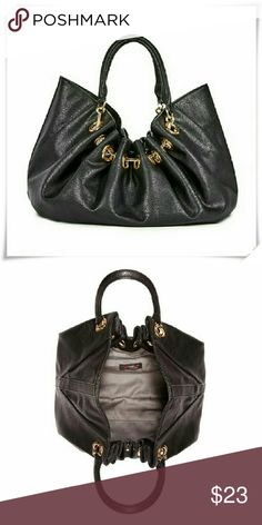 "Gunnar bag. Faux leather. 1 interior pocket, one interior with zipper. Details: L 14- 1/2"", H 13"", D 6"", shoulder drop 8"". JustFab Bags"