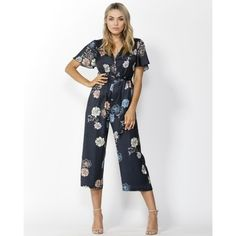 Save The World Jumpsuit in Aurora Print by FATE & BECKER. The jumpsuit flares down along the leg and sits approximately mid-leg. Comes in Aurora Print and Burnt Orange  Pair this jumpsuit with sneakers for a casual look or with heels and statement earrings for a night out with the girls. #jumpsuit #fashion #spring #alibionline Flowy Shorts, Fashion Spring, Burnt Orange, Statement Earrings, Casual Looks, Aurora, Night Out, Short Sleeves, Jumpsuit