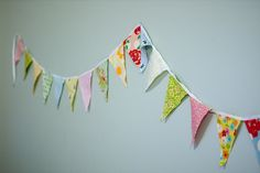 Thinking of appliquing  a bunting like this across a white duvet cover for the twin bed in Adelyn's room...
