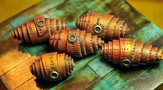 Copper rolled beads from Page's Creations.