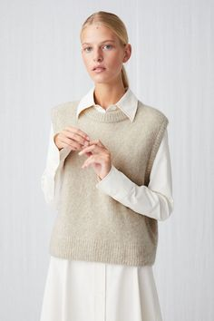A blend of alpaca, cashmere and mohair offers an airy softness and warmth to this plain-knitted slipover vest. A regular fitted style with ribbed trimmings. Wool Vest, Knit Vest, Sweater Vest Outfit, Vest Outfits For Women, Chic Outfits, Fashion Outfits, Western Outfits, Korean Outfits, Wool Sweaters