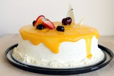 Vanilla cake moistened with a tres leches mixture of condensed milk, evaporated milk and whole milk. The cake is filled with a mango sauce, frosted with a light whipped cream and drizzled with mango sauce for a light, refreshing cake experience!