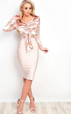 """This shirt is sooo lush! This stunner is cropped satin style with a knot-tie feature! Take this beaut from day to night! You can also wear this beaut with leather pants and rose gold heels for the perf look! Polyester/ElastaneUnderarm to hemline is approx. 8""""Darcy is 5,7"""" and wears a size SRoseTrue to sizeUK sizes.   eBay!"""