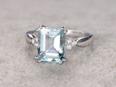 Blue Aquamarine Engagement ring with diamonds, 14K&18K Rose/Yellow/White Gold Available. Every Jewelry in my store needs making to order. [Item details]Engagement Ring:Solid 14K White Gold(Can be made in white/yellow/rose gold)Size 6#(Ring can be resized)8X10mm 3.55ct Emerald Cut Natural IF Blue Aquamarine0.1ctw Round Cut VS-H Natural Conflict Free Diamonds.Prong Set------Matching band can be made for the gemstone ring. Matching Band 1(Milgrain Art deco half eterni...