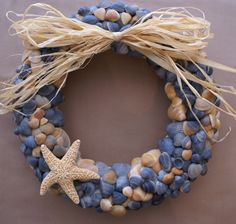 "Seashell wreath, 11"" blue beach wreath coastal decor nautical cottage chic. $74.99, via Etsy."