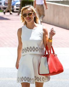 Reese Witherspoon rocked a flirty white frock with cutout details while in Beverly Hills. Her colorful bag is so cute!