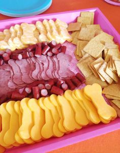 use dog bone cookie cutter to make this meat and cheese tray - paw patrol